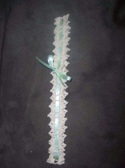 Ivory lace with a green satin ribbon