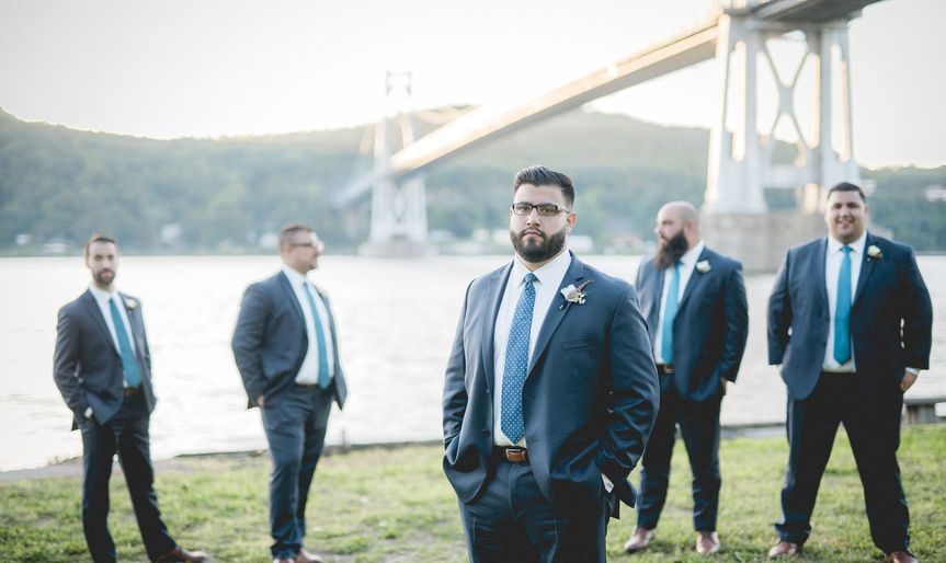 Groom and his groomsmen by the water