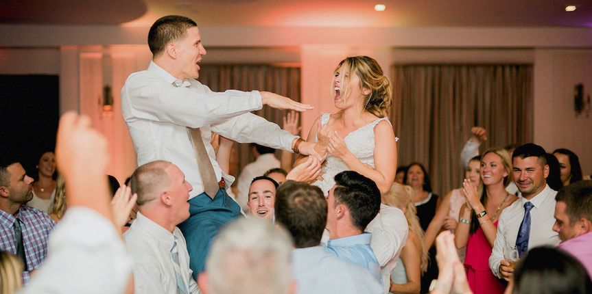 Lifting up the newlyweds
