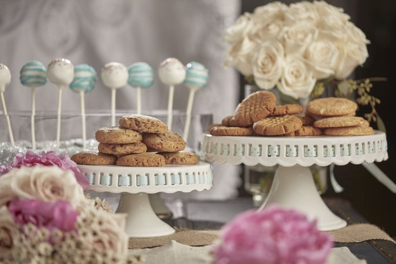 Dessert Bar with Gluten Free Cookies, CakePops and multiple floral arrangements.