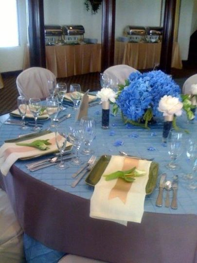 Elegant tablesetting with French blue hydrangea, white peonies, blueberries and white Parrot tulips....