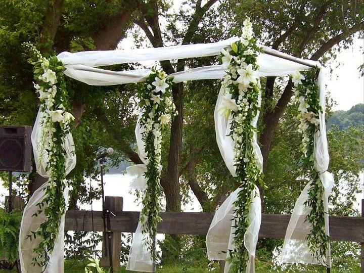 Tmx 1347481264551 Floralaccentsceremony1arborwithorganzawhiteflowerswags North Tonawanda wedding florist
