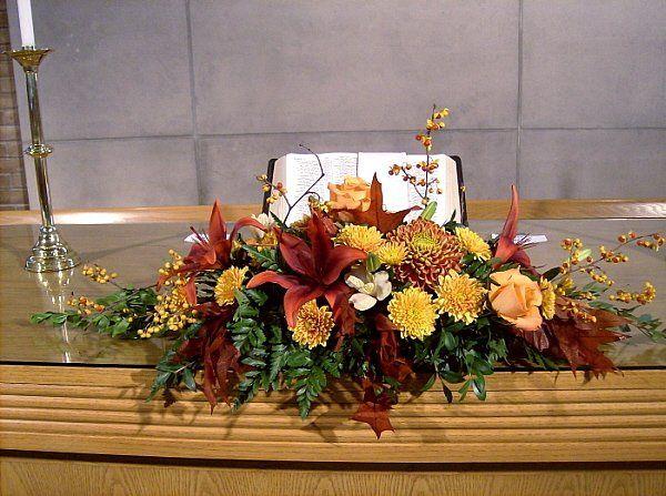 Tmx 1347481372103 Floralaccentsceremonyalterpiececopperlilyfallleavesbittersweet North Tonawanda wedding florist