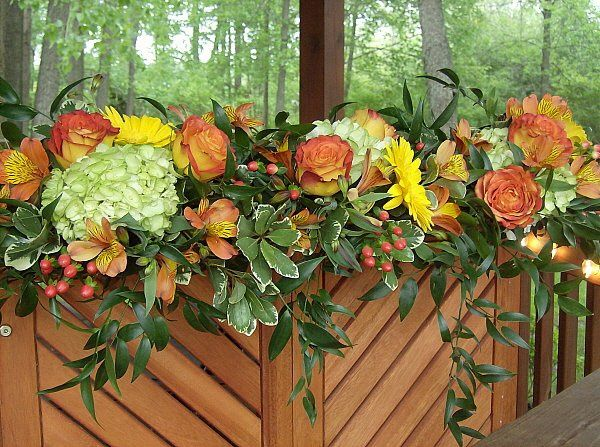 Tmx 1347481437604 Floralaccentsceremonygreenorangeyellowmixedgreens North Tonawanda wedding florist