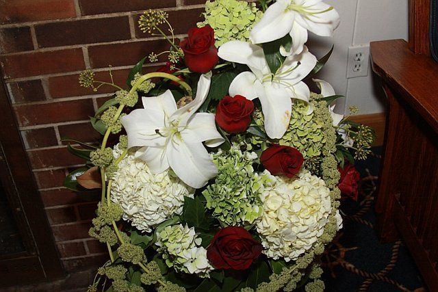 Tmx 1347481470717 Floralaccentsceremonypattyfiresidebasketredwhitegreen North Tonawanda wedding florist