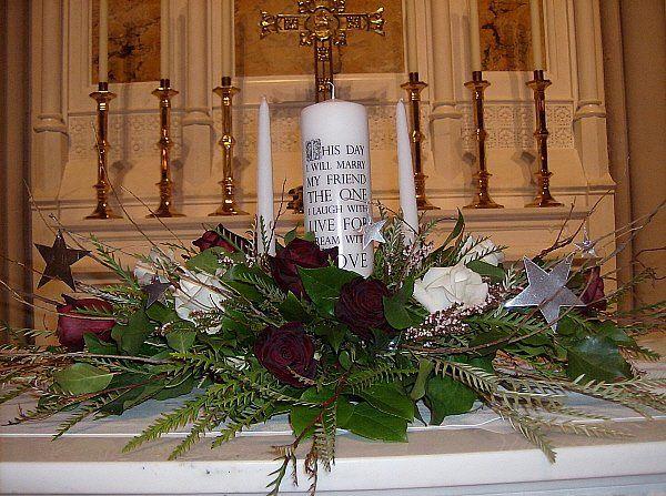 Tmx 1347481589011 Floralaccentsceremonyunitycandlesilverstarsbranchesredwhiteroses North Tonawanda wedding florist