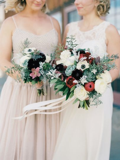 Bride and bridesmaid holding bouquets