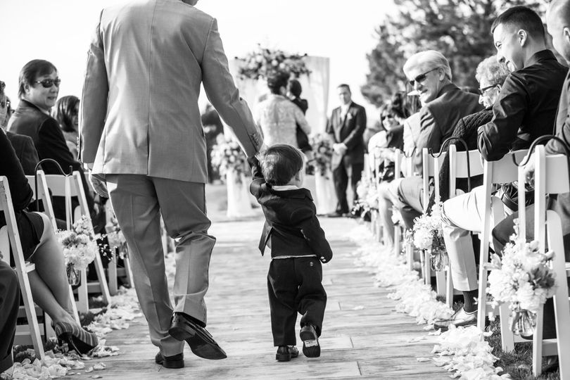 Ring bearer walking up the aisle in black and white, Boundary Oak wedding