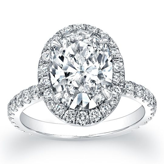 Pave Diamond Halo Engagement RingThis spectacular engagement ring is completely hand-made...