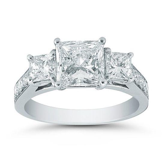 Platinum Three Stone Princess Cut & Pave SettingThe dazzling 1.59ct Princess cut center...