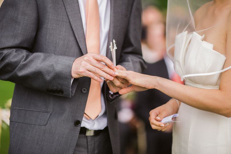 photo of groom putting wedding ring on his bride 1026390 51 1969651 159200545428015