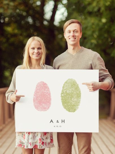 couple holding sign horizontal baby pink and avoca
