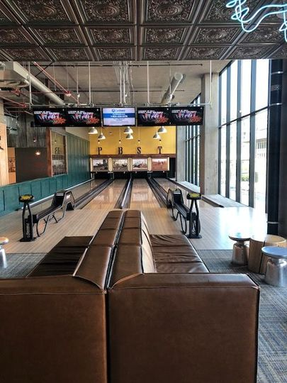 Bowling lanes and couch area