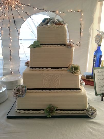 "Four tier with ""map"" flowers and compass"