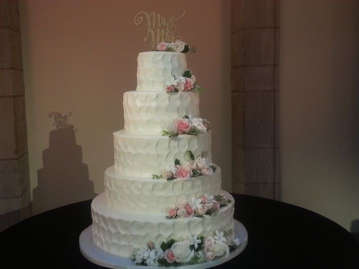 Five tier textured buttercream with flowers