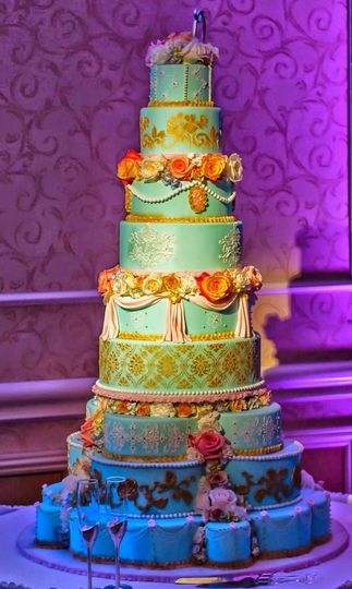 Victorian themed cake with intricate details and a rotating top half