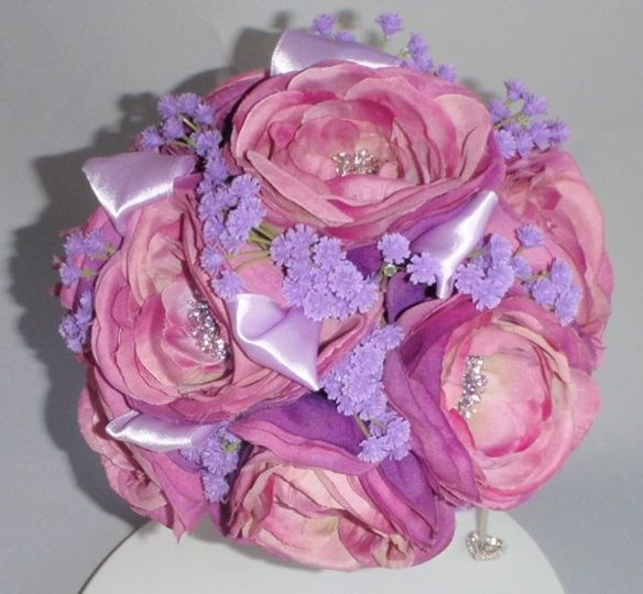 Bouquet of Pink and lilac silk flowers with rhinestone brooches and lilac ribbon accent