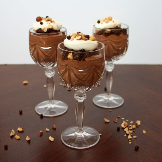 nutella mousse with cookie crumble, hazelnuts, and whipped cream