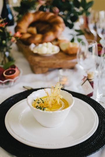 roasted blue hubbard squash soup with crispy parsnips, creme fraiche, and chives
