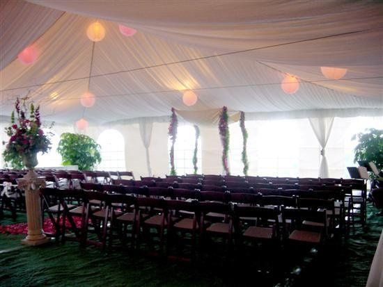 Tent with ceiling liner and lighting, and ceremony chairs
