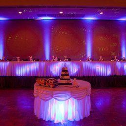 Wedding cake on a lighted table