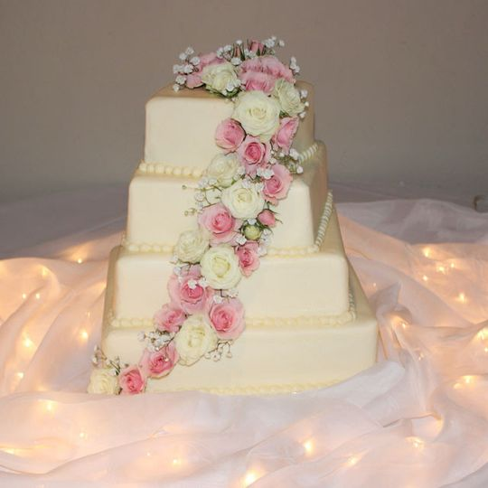 Cascading floral cake décor