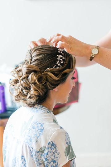 Loose updo for our beautiful bride kelly