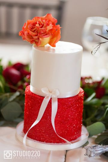 Sparkly red glitter cake with a delicate fire rose made from sugar paste.  Photography:...