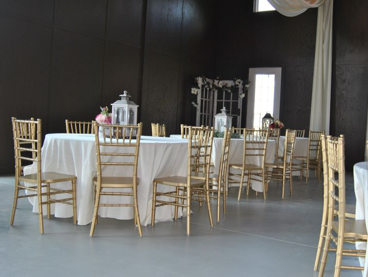 Our elegant round table option with white or ivory linens provided