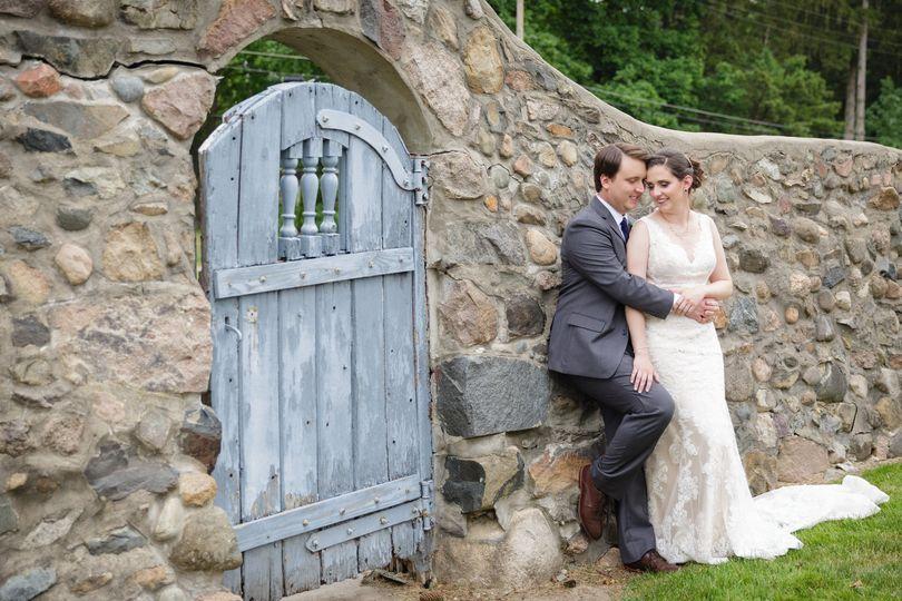 Bride & groom at stone wall