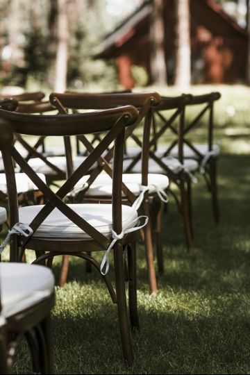 Wooden chairs set for ceremony