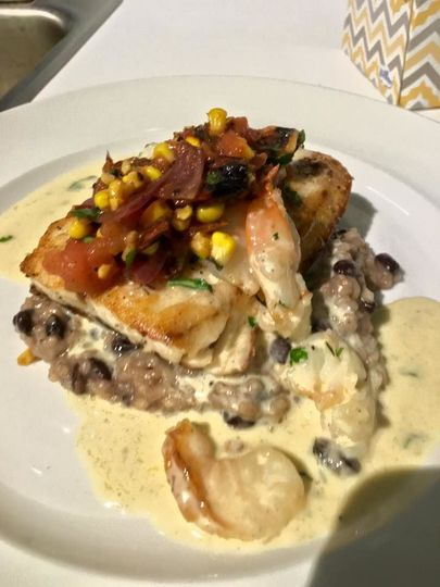 Striped Bass with a Shrimp Cream Sauce  on Black Bean Risotto with Tomato-Corn Salsa