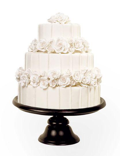 Whimsical fantasy wedding cake with spun sugar and edible flowers