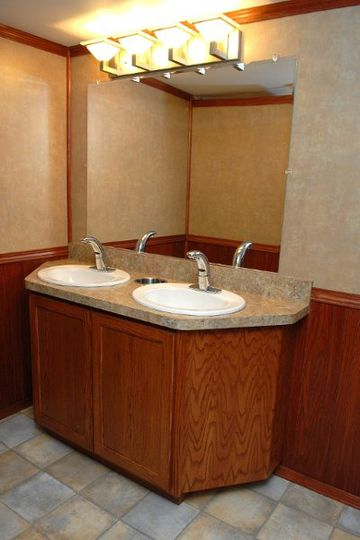 Two full size sinks with hands free faucets and soap dispensers in each restroom.