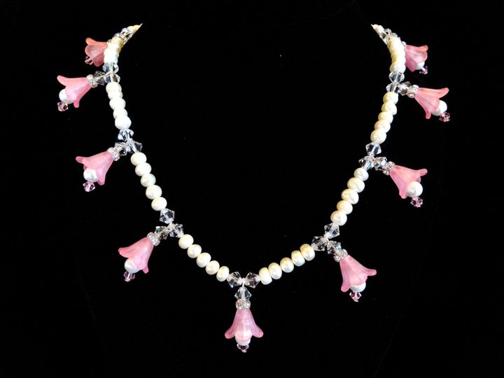 Very pretty pink flower and white cultured pearl necklace. Unique and elegant!