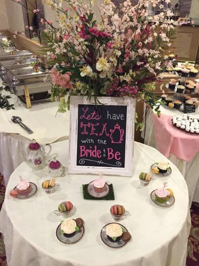 Dessert table with floral centerpiece