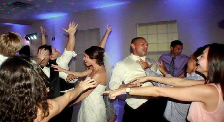 Couple dancing with their guests'