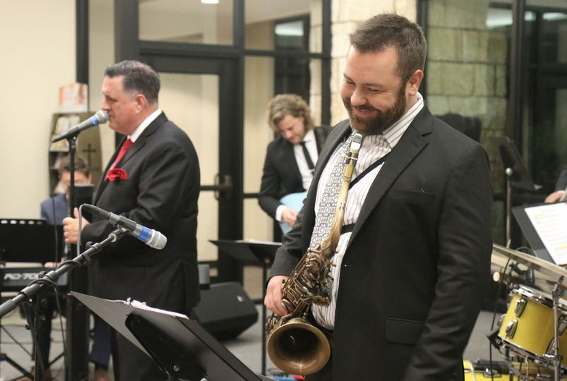 Sax players laugh when bored.