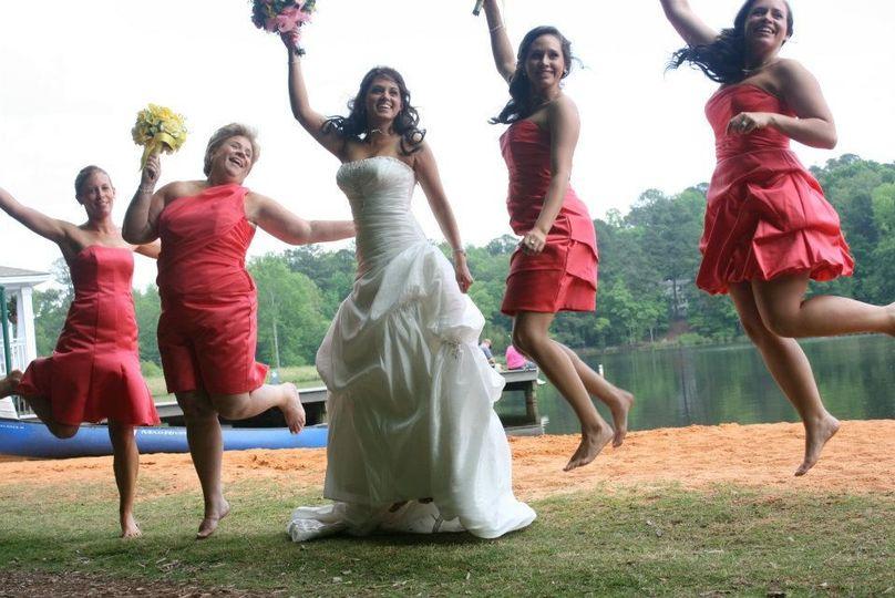 Jump shot of bride and bridesmaids