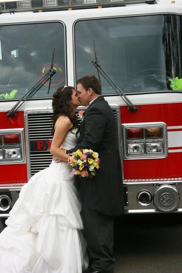 Kissing by the firetruck