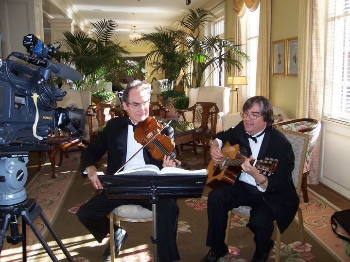 Guitar and Violin can play classical, folk, Irish, popular, broadway and bluegrass for your ceremony...