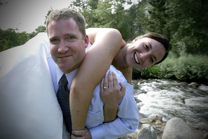 Taking his bride on his shoulders!
