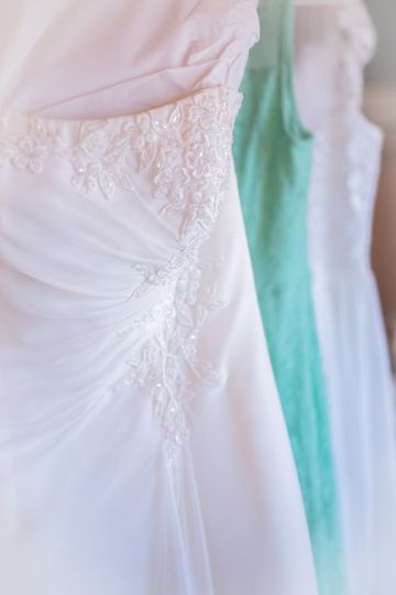 Sandy's wedding gown at forefront and bridesmaids' gowns