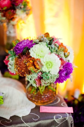 Centerpiece design by Brittni Genova Photography Courtesy of William McKee with The Collective...