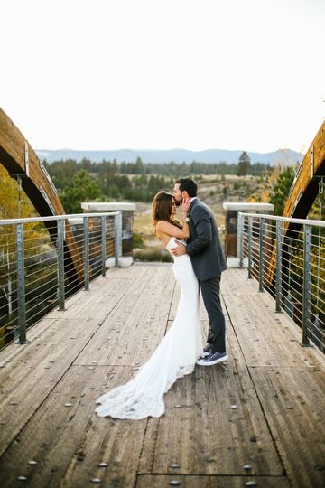 Newlyweds kiss on the bridge