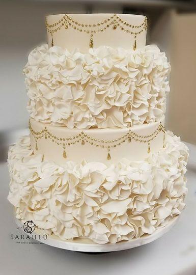 Classic white cake with ruffles