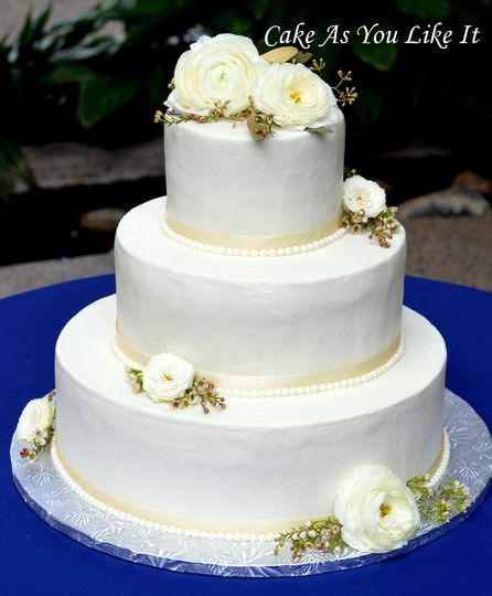 """14"""", 10"""" and 6"""" cakes.  Iced in buttercream and finished with fresh flowers.  Chocolate, lemon and..."""