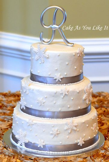 """10"""", 8"""" and 6"""" cakes for 75 servings.  Vanilla and Strawberry cakes iced in buttercream and finished..."""