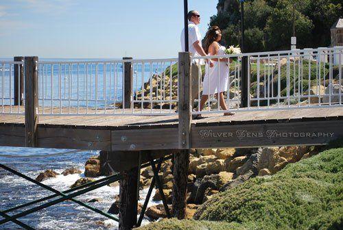 Bride & Groom walking on Pier.2