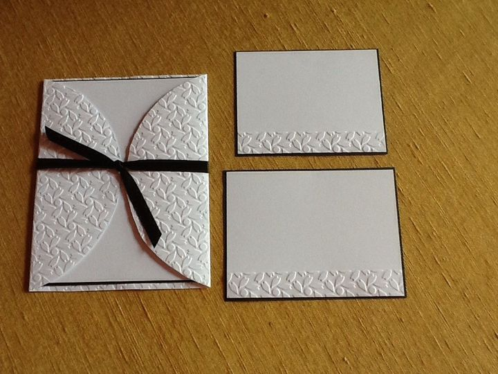 Embossed patchwork design with black ribbon. Invitation mounted inside on black card stock....